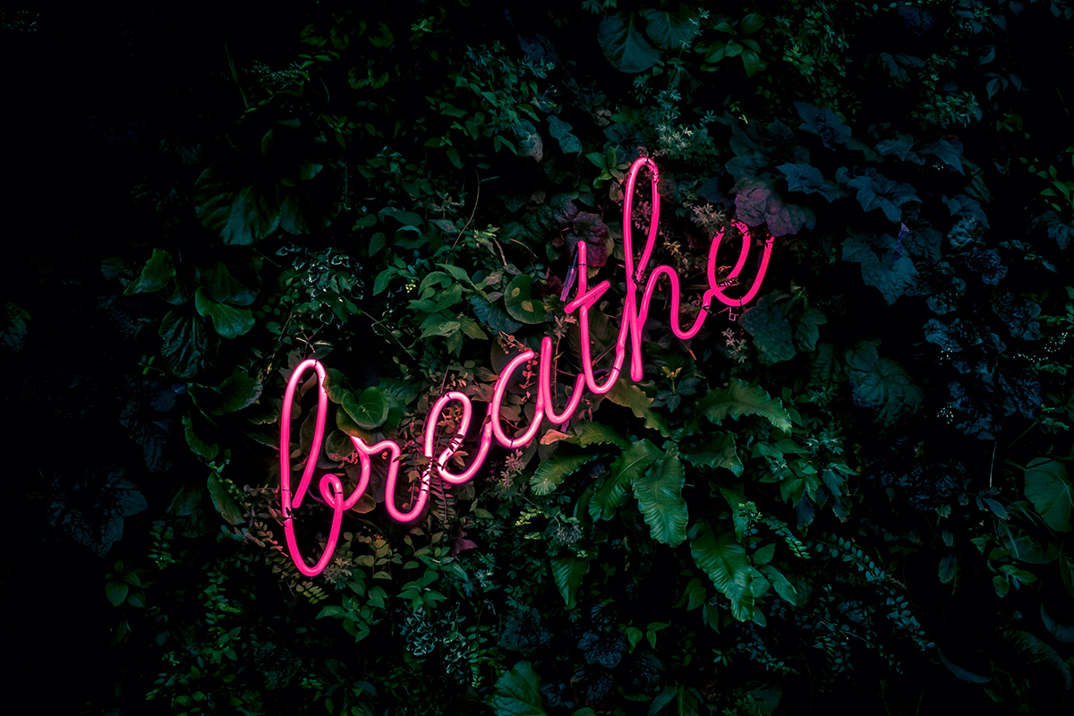Breathe written in pink neon